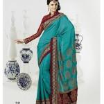 Green designer party wear sarees by Brinda