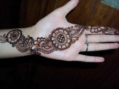 New Party Wedding Mehndi Designs 2012 For Ladies